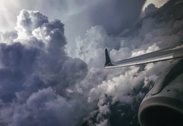 Twin engine airliner avoiding area of turbulence.